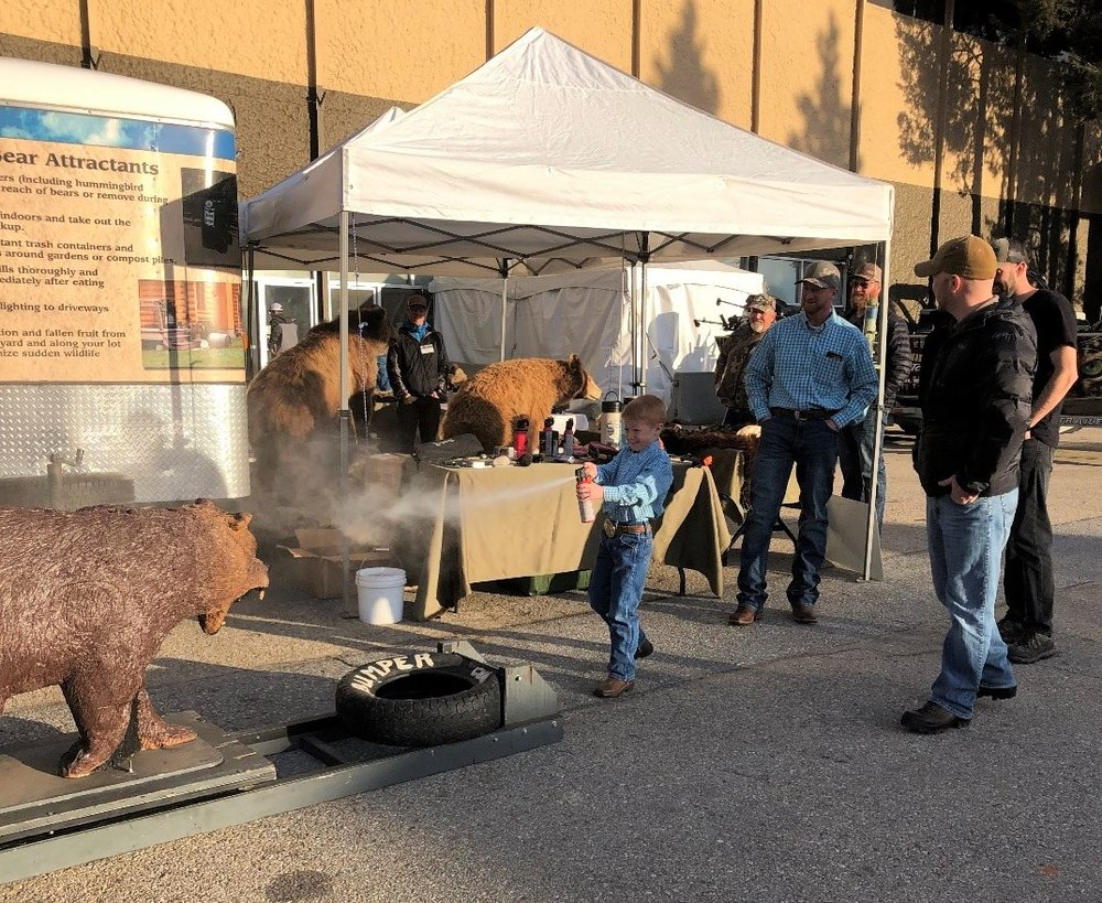 A young sportsman at the Idaho Sportsman Show in Boise, ID practices his bear spray skills. (Photo GYC.)