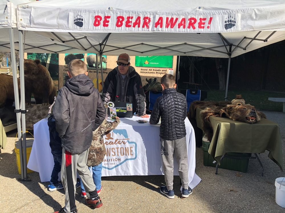 Greater Yellowstone Coalition's Mac Dukart educating on bear awareness and safety at the Idaho Sportsman Show. (Photo GYC.)