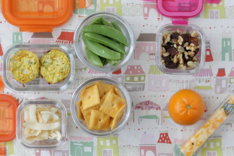 Yummy Toddler Lunch: Egg Muffins, coconut chips, peas, and crackers via yummytodderfood.com