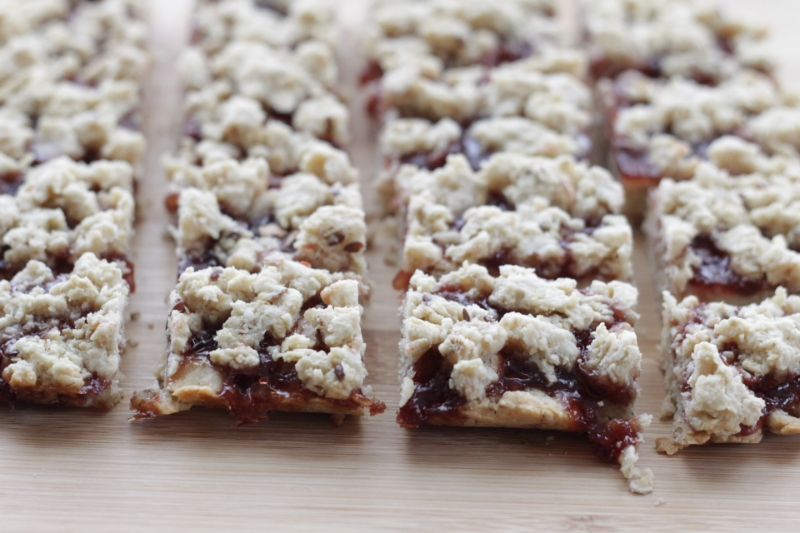 Oatmeal Jam Bars, with a secret ingredient in the crust that makes them super moist!