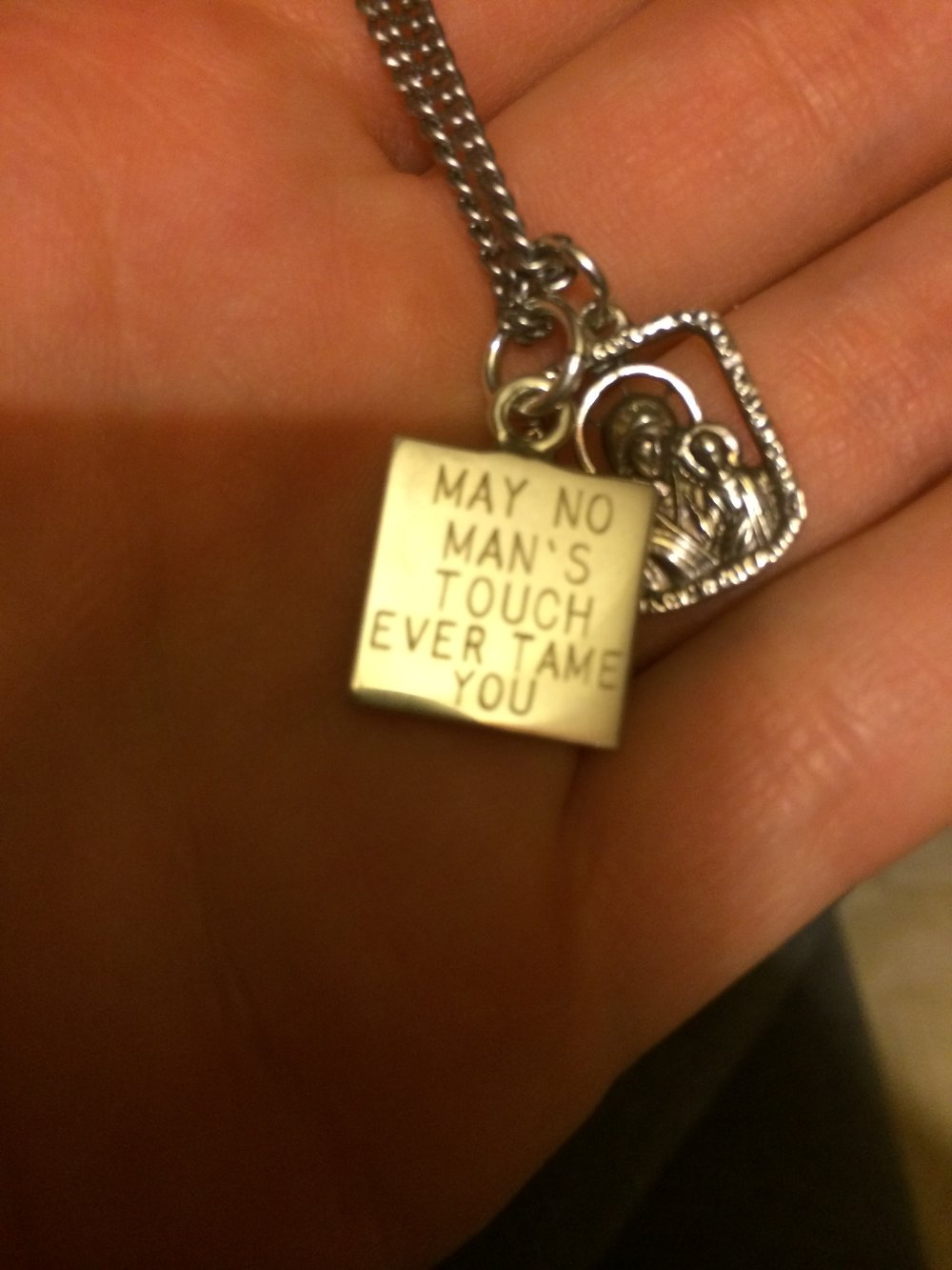 I also did strange things like make symbolic jewelry after breaking up with assholes who scared the bajeezus out of me. This necklace charm has a quote from a favorite Ray LaMontagne song of mine.