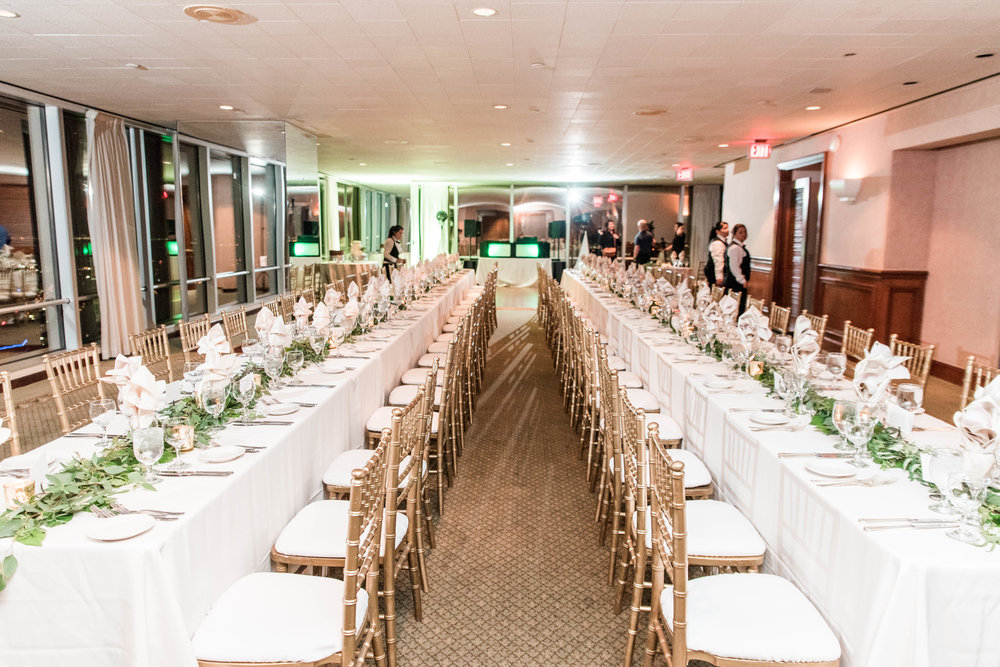 Family style tables flanked both sides of the dance floor.