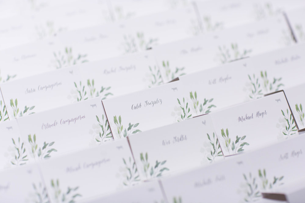 Before going into the banquet hall for dinner, guests grabbed their name cards.