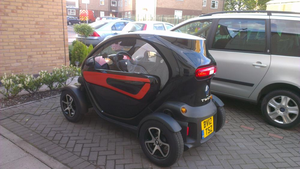 Black Twizy with windows from Twizywindows.co.uk