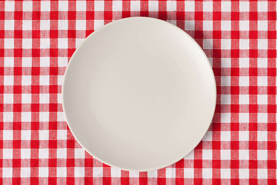plate on checkered table