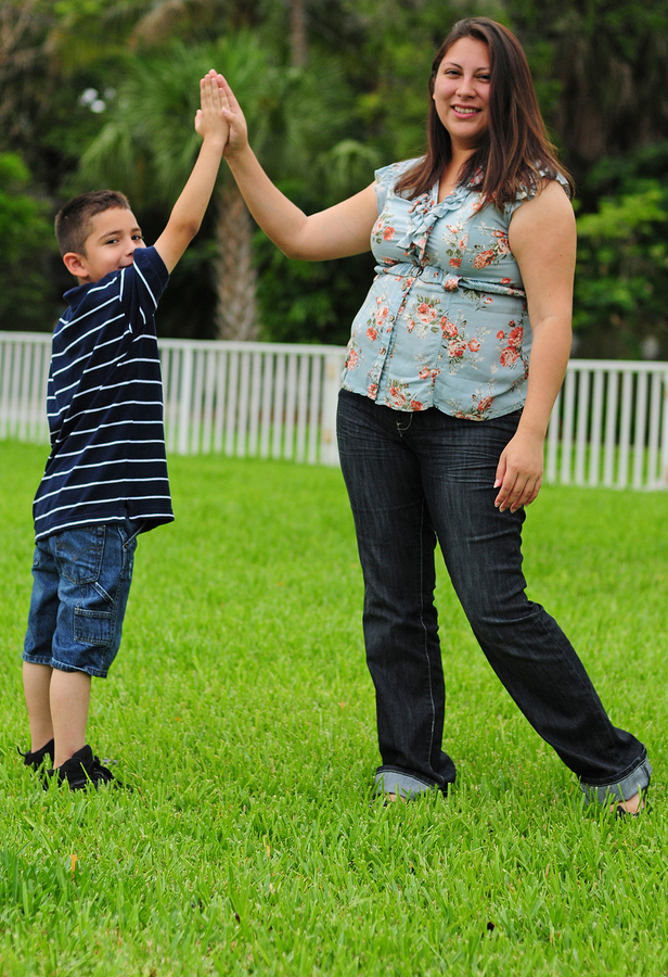 mother and son high five