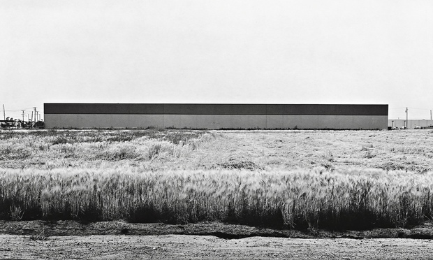 (1) Lewis Baltz,   East Wall, Western Carpet Mills, 1231 Warner, Tustin   (1974) ©   New Topographics,   Steidl, 2009