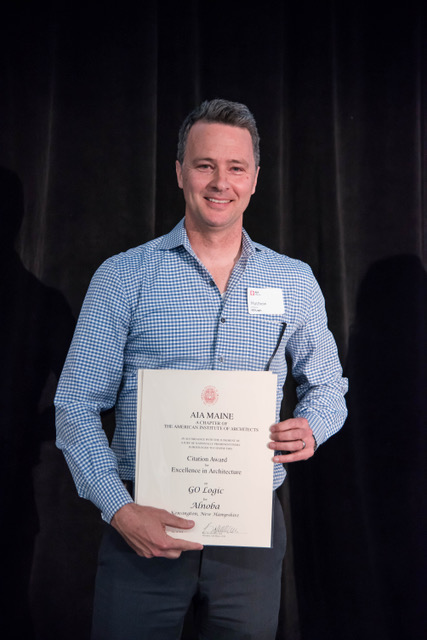 Matt O'Malia of GO Logic accepts the award for Alnoba.