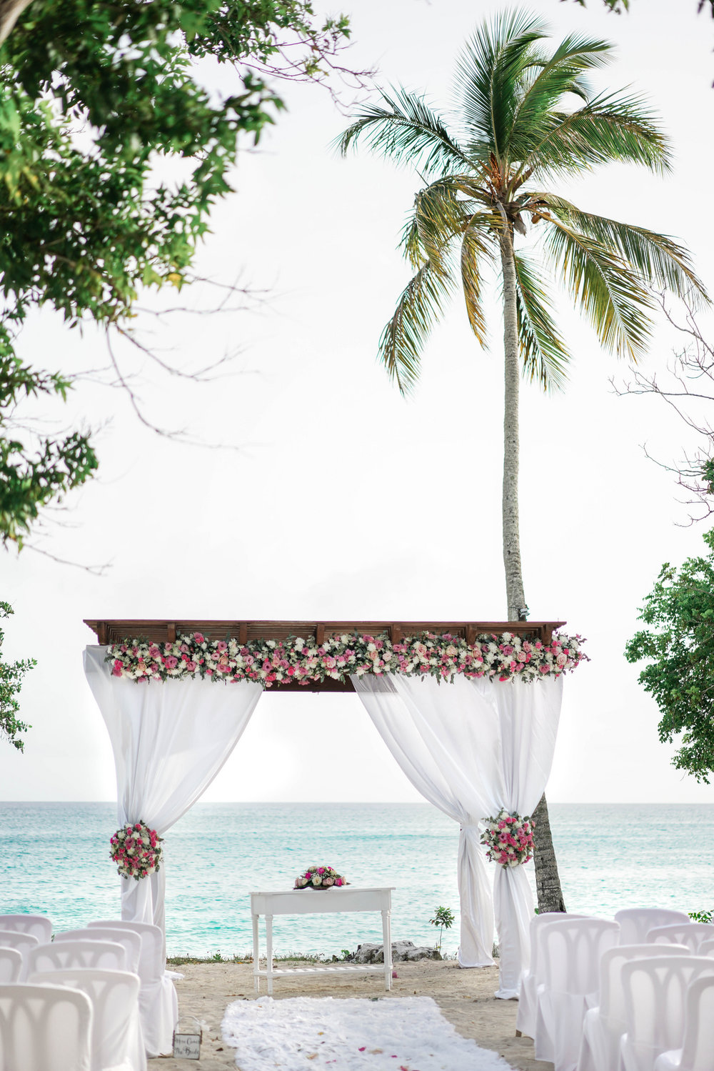 La Romana, Dominican Republic Destination Wedding. Beautiful beach wedding ceremony by a Texas destination wedding photographer.