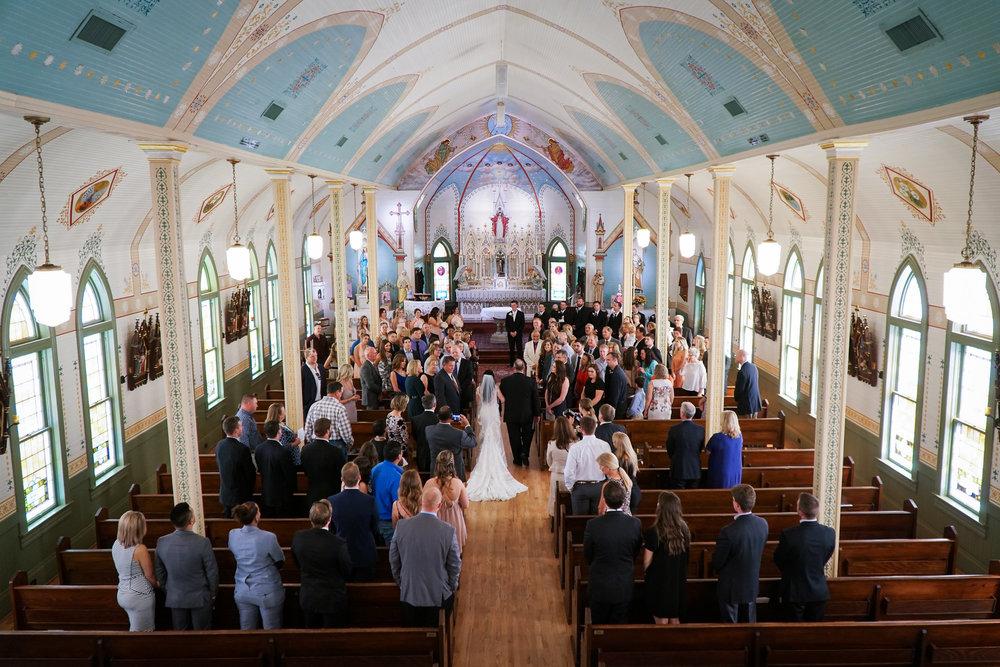 Olde Dobbin Station Houston Wedding Photographer. Wedding Photos from Olde Dobbin Station. Ceremony at St. Mary's Catholic Church in Montgomery, Texas.