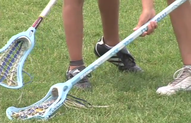 In this image, the lower of the two sticks is illegally covering the ball with the back of her stick.  Her opponent has no chance of getting the ball because of this.