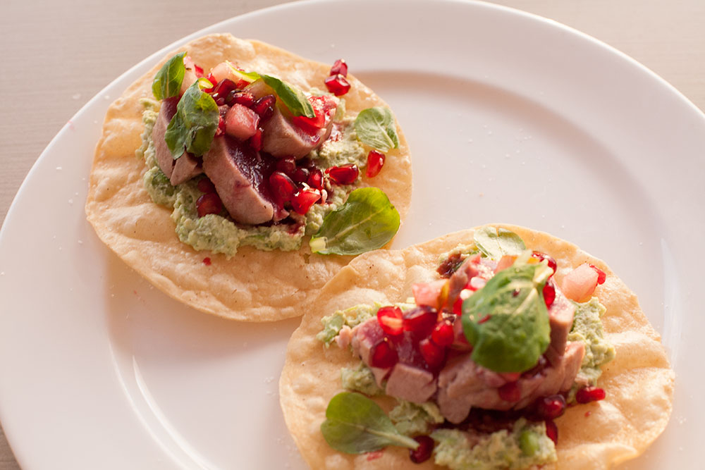 """Seared Ahi Tostada with """"Sweet and Sour"""" Pomegranate Reduction"""