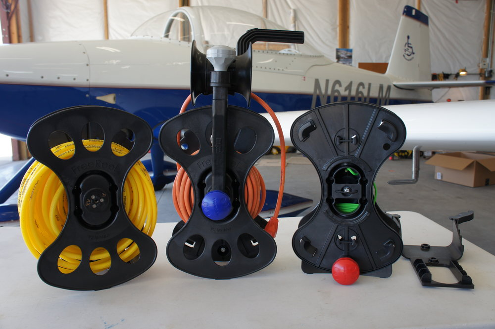 FreeReels with an air hose, a power cord and paracord