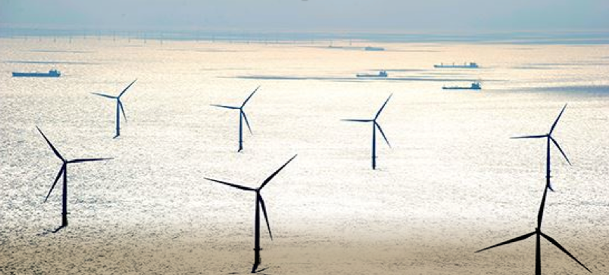 Operating offshore wind farm in the UK showing shipping traffic in the background.   © Crown Copyright 2015