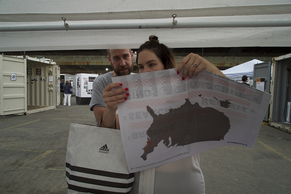 Visitors to Toxic Sites US tent at Photoville check out our paper map.