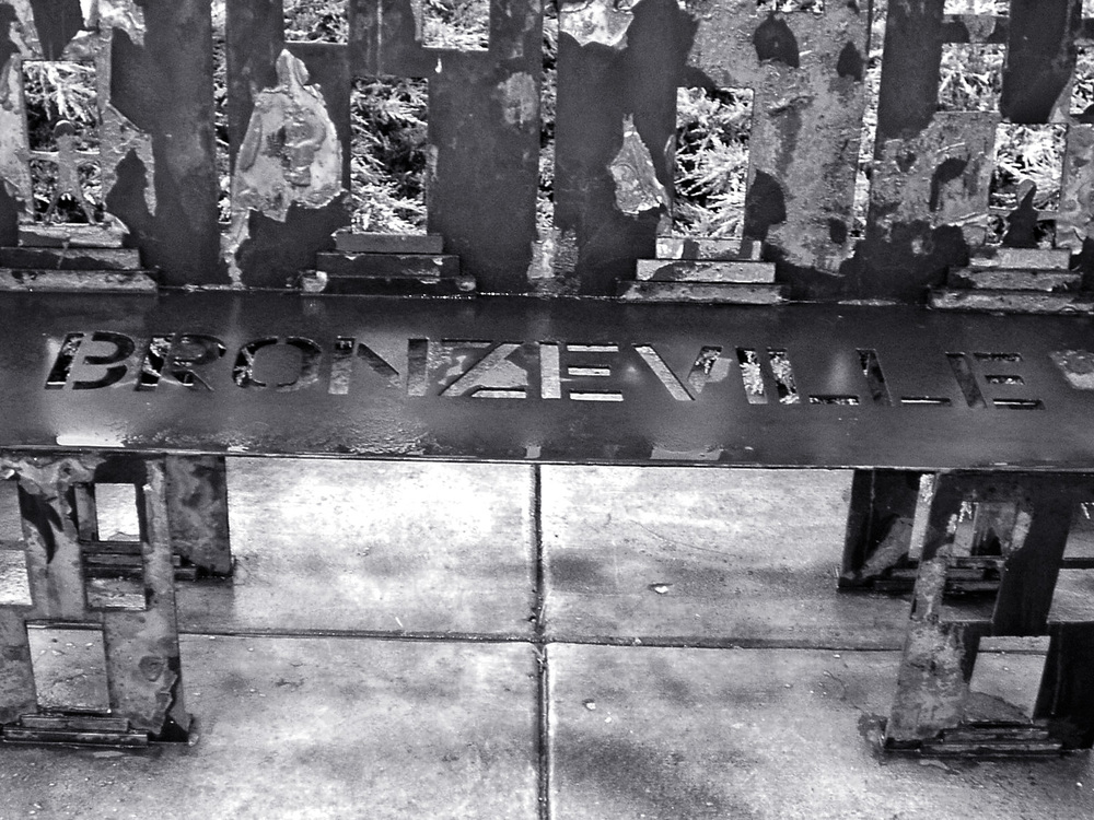 """ bronzeville bench "" ( CC BY-NC-ND 2.0 )   by     samuelalove  Cropped from original"