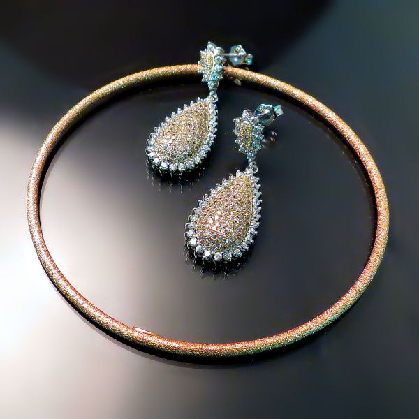 Good imitation jewellery set in rose gold plate silver with cubic zirconia earrings and bangle