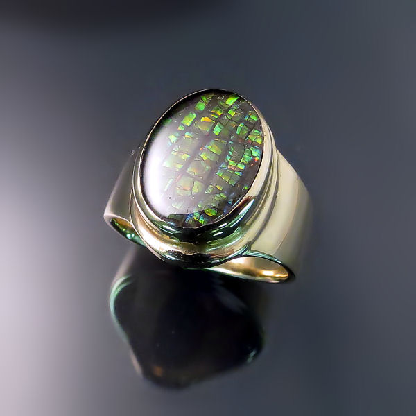 Sophisticated modern design jewellery: gold ammolite ring
