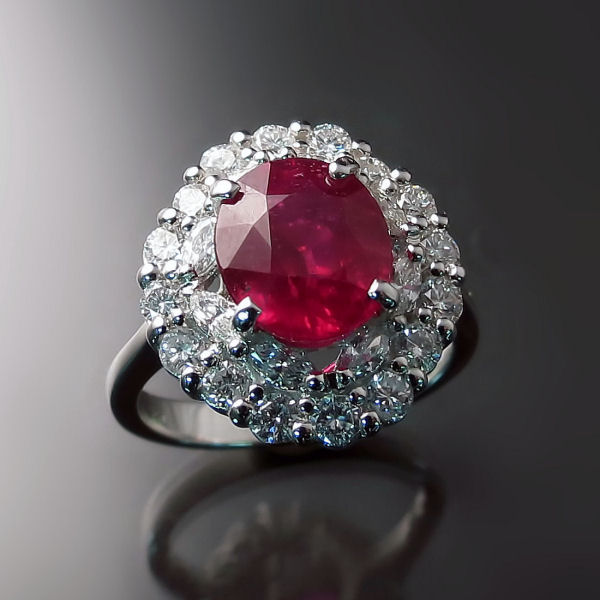 A stunning cocktail ring featuring a large ruby surrounded by 2 rows of sparkling diamonds.   Click here to shop online.