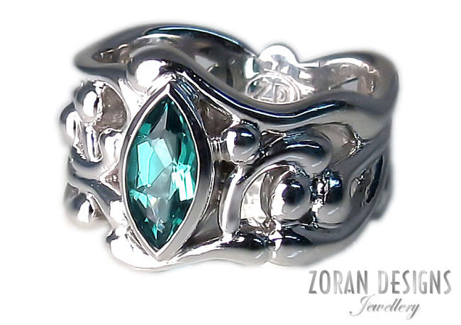 Custom jewellery: organic design platinum ring with marquise emerald