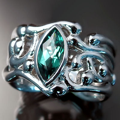 Platinum emerald ring with organic design