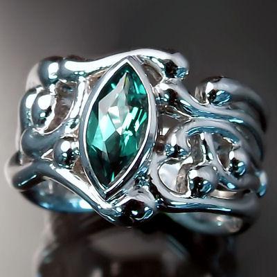 Platinum emerald ring with organic design
