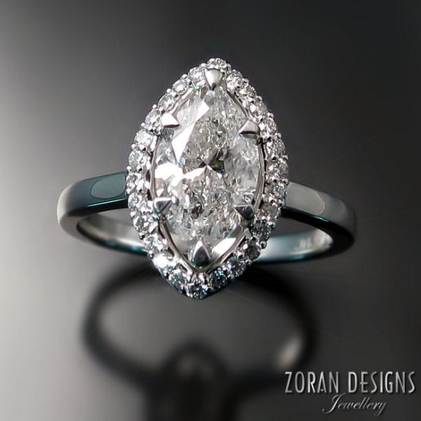 Custom made engagement ring: marquise diamond with halo in 18K white gold