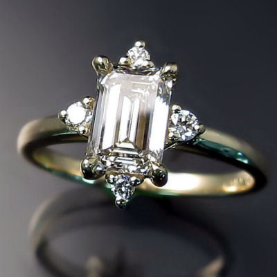 Custom engagement ring: emerald cut diamond