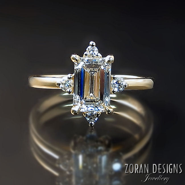 Bespoke engagement ring made with an emerald cut diamond