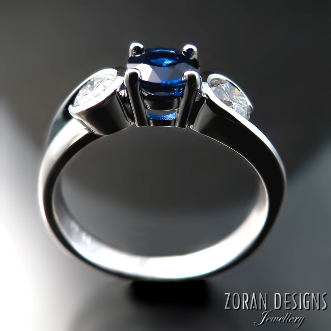 Unique engagement ring with sapphire and diamonds