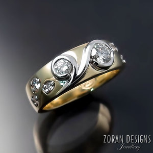 44fc172e7e9586 unique_two_tone_gold_diamond_wedding_ring.jpg. 13. Custom Made Jewellery