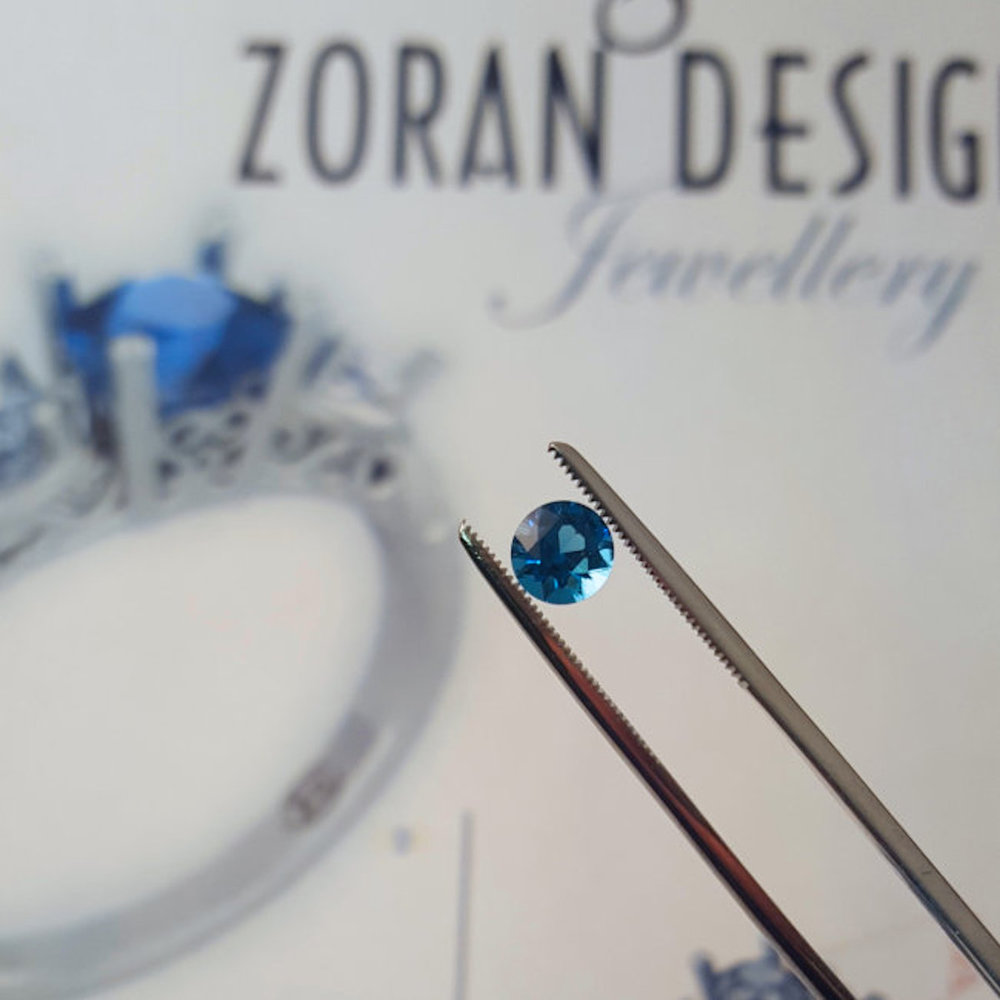 Sapphire stone personally cut and polished by my client and to be the centre of a custom engagement ring