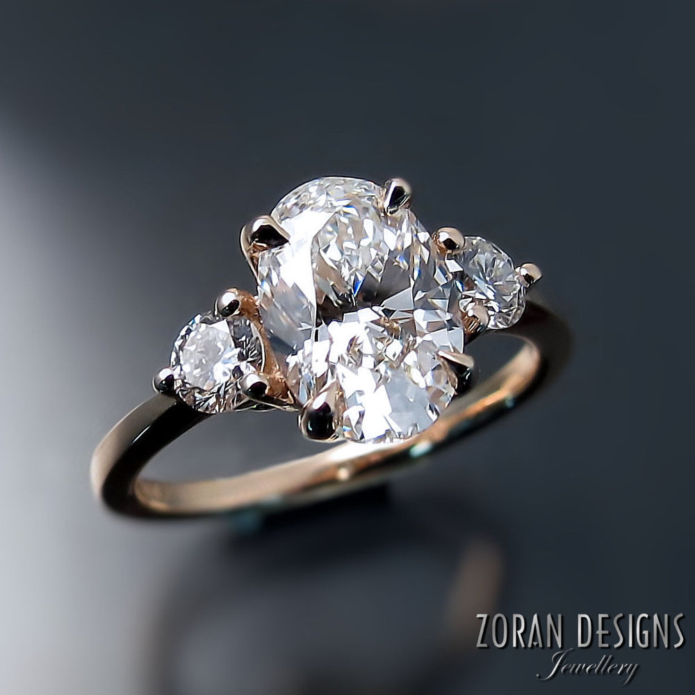 A gorgeous 1.5 carat GIA diamond is the focal point for this classic engagement ring