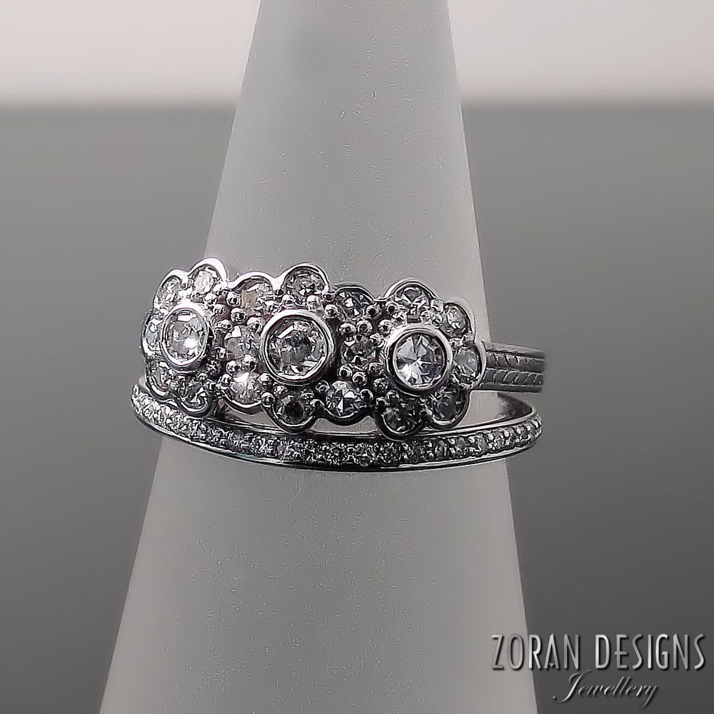 The diamonds in this Art Deco inspired, DAISY design engagement ring were repurposed from a family heirloom