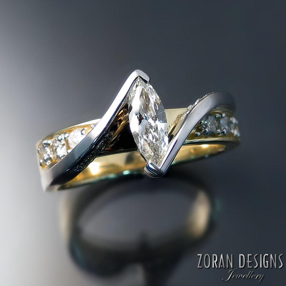 Custom made two tone gold ring designed around client's repurposed diamonds