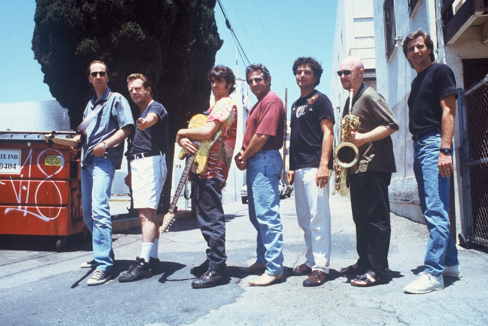 "from left to right: Fer Bos (bass), the late John ""Juke"" Logan (harmonica), Russ Parrish (guitar), John Herzfeld (director), Anthony Marinelli (composer), Brandon Fields (saxophone) and Mark Curry (engineer)"