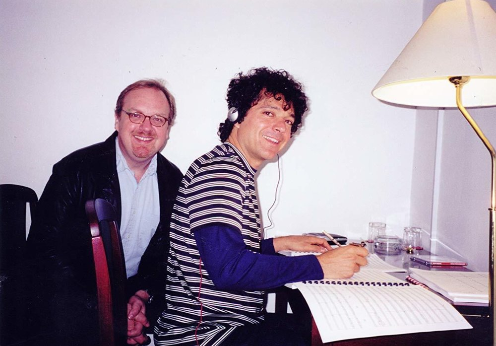 """Director George Hickenlooper with Anthony Marinelli reviewing Anthony's music to be performed by the Prague Symphony for """"The Man from Elysian Fields"""",  Prague, Czech Republic, 2001"""