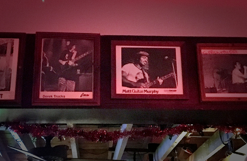 Photographs of bluesmen cover the walls of The Double Door