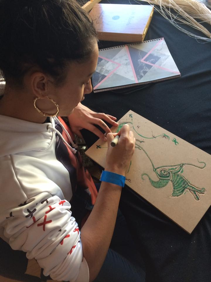 Contemporary Maori Artist, Miriama Grace-Smith working. A selection of Miriama's art prints will be available on the night.