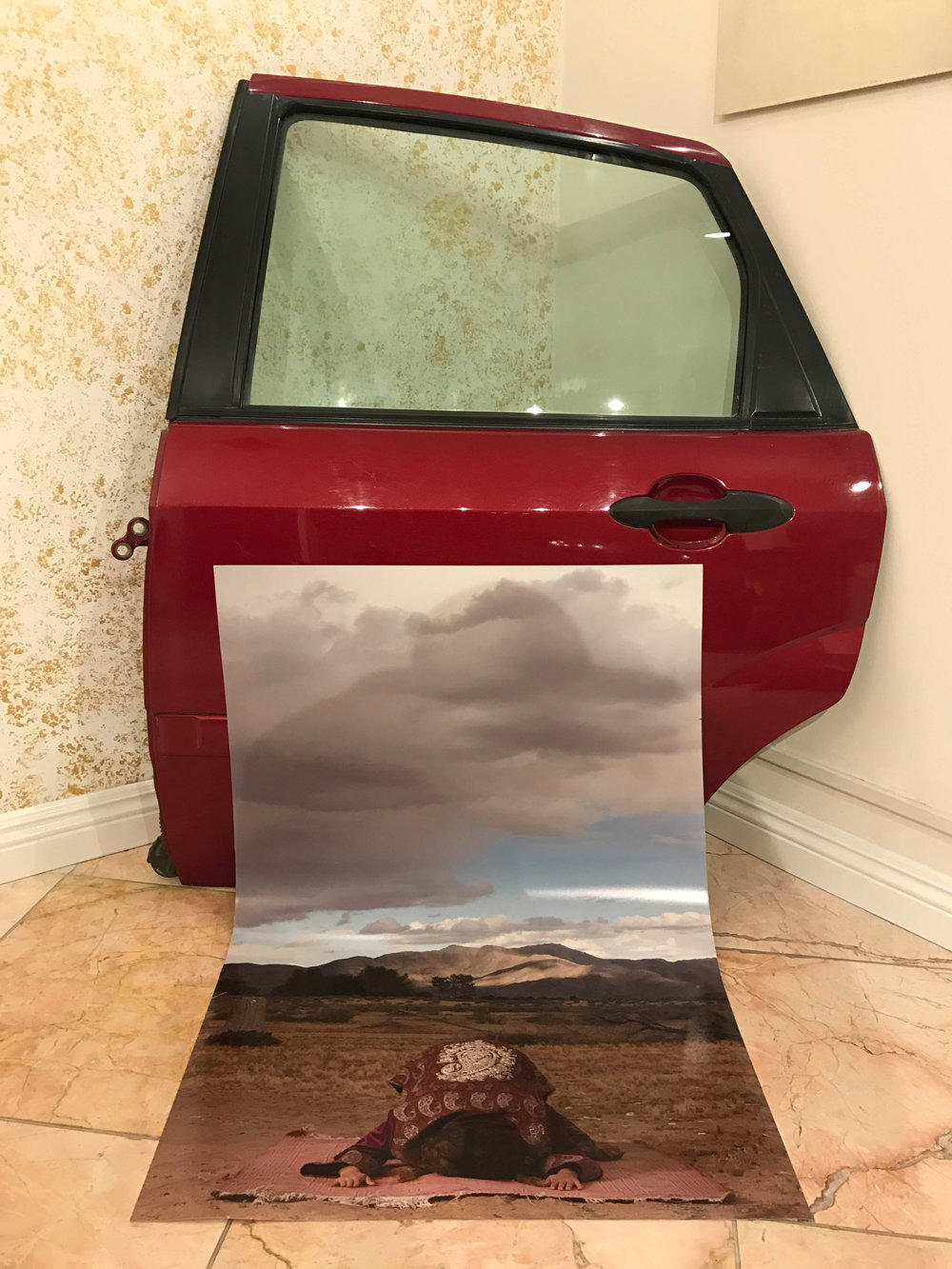 "Alexandre Dorriz, ""American Namaste / 2001 Ford Focus (Daughter IX)"", 2017.  From the ""Meditations / Archives""  S eries.  (Installation View) Metal, Glass, Rubber, Fiberglass, Archival Inkjet Print."