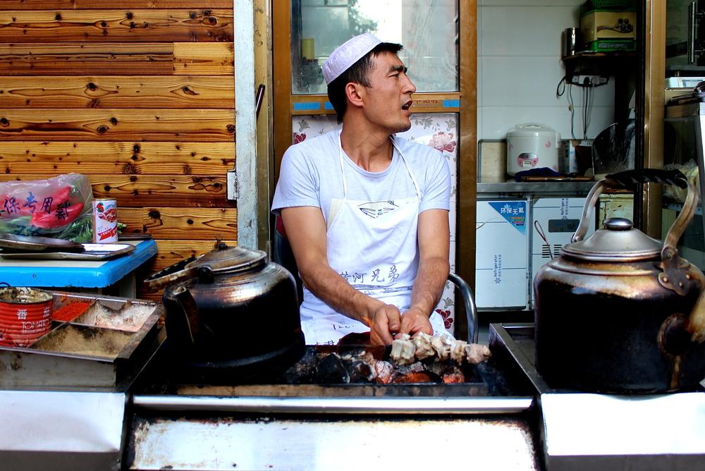 Salar man preparing lamb chuars