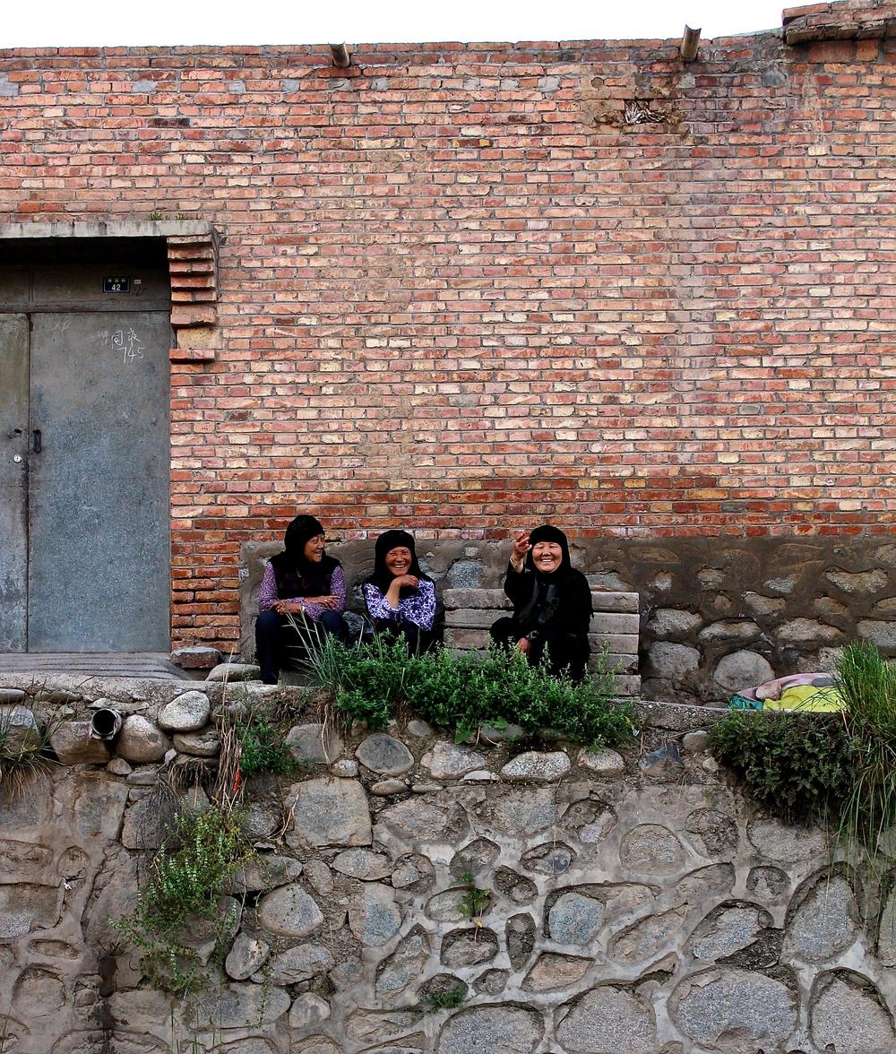 Salar women outside of their home in Tongren, Qinghai
