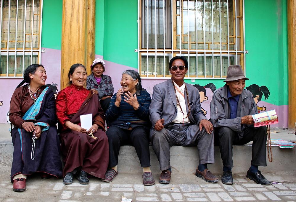 Tibetan friends chatting on the street in Tongren, Qinghai