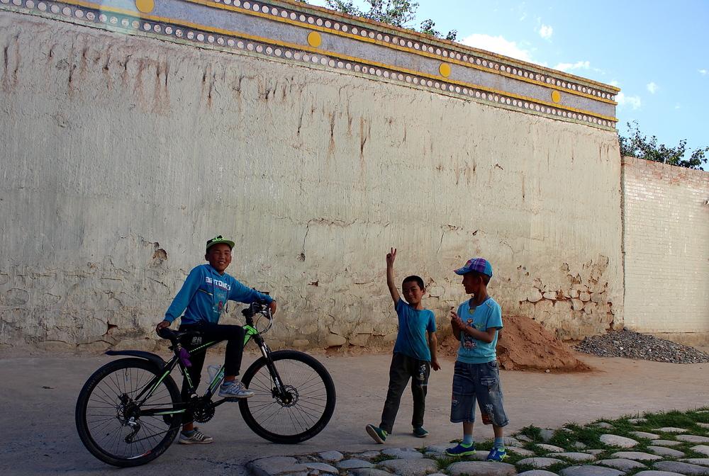 Tu children playing in their village next to Regong