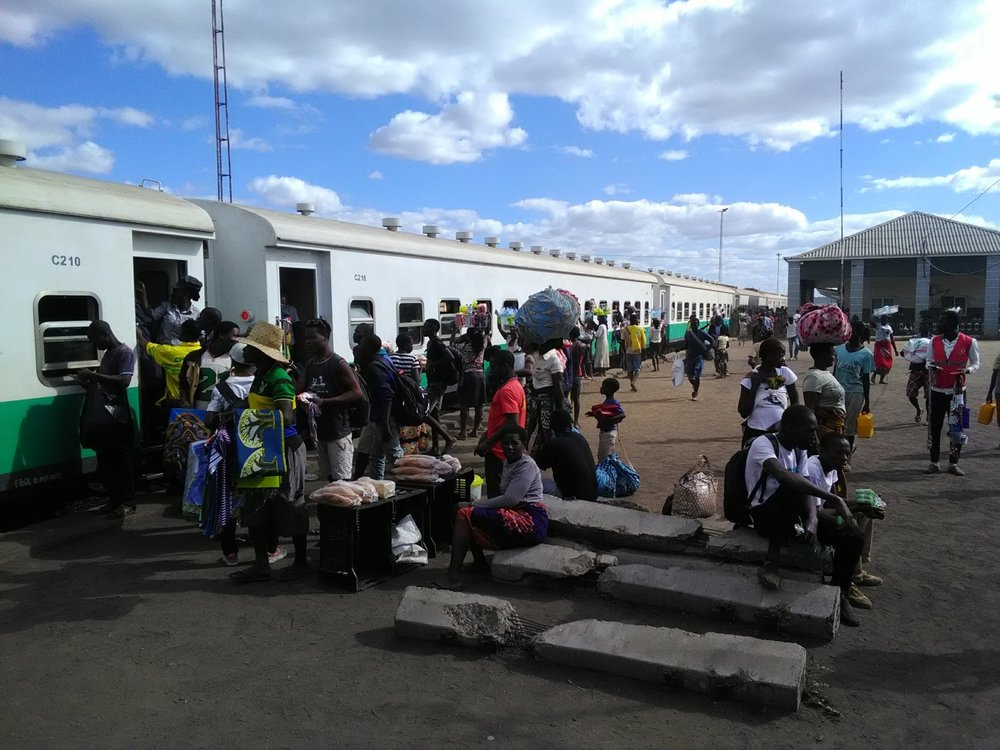 Passengers boarding train on the Beira Corridor. While the railway is mainly used for the transport of coal, there are a few weekly regular passenger services. Photo: Eric Cezne/ June2018