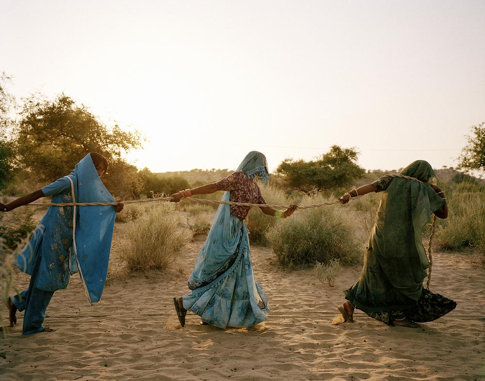 Women pull water from a well. Tharpakar, Pakistan, 2013.