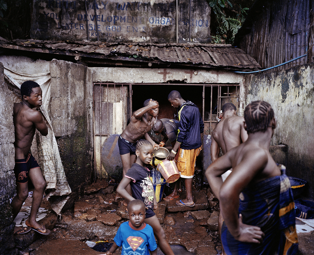 Water point. Kroo Bay, Freetown, Sierra Leone, 2012.