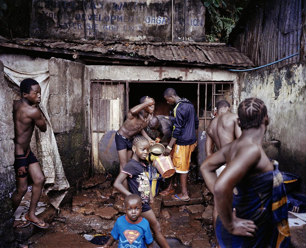 Water point. Kroo Bay, Freetown, Sierra Leone, 2012.