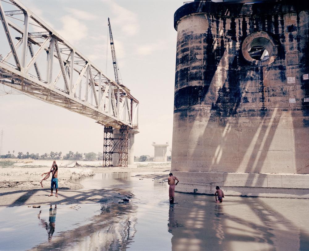 Construction of bridge over Ganges tributary. Bihar Province, India, 2013.