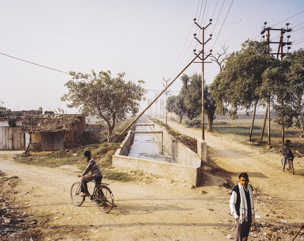 Pollution canals through agriculture fields. Kanpur, India, 2014.